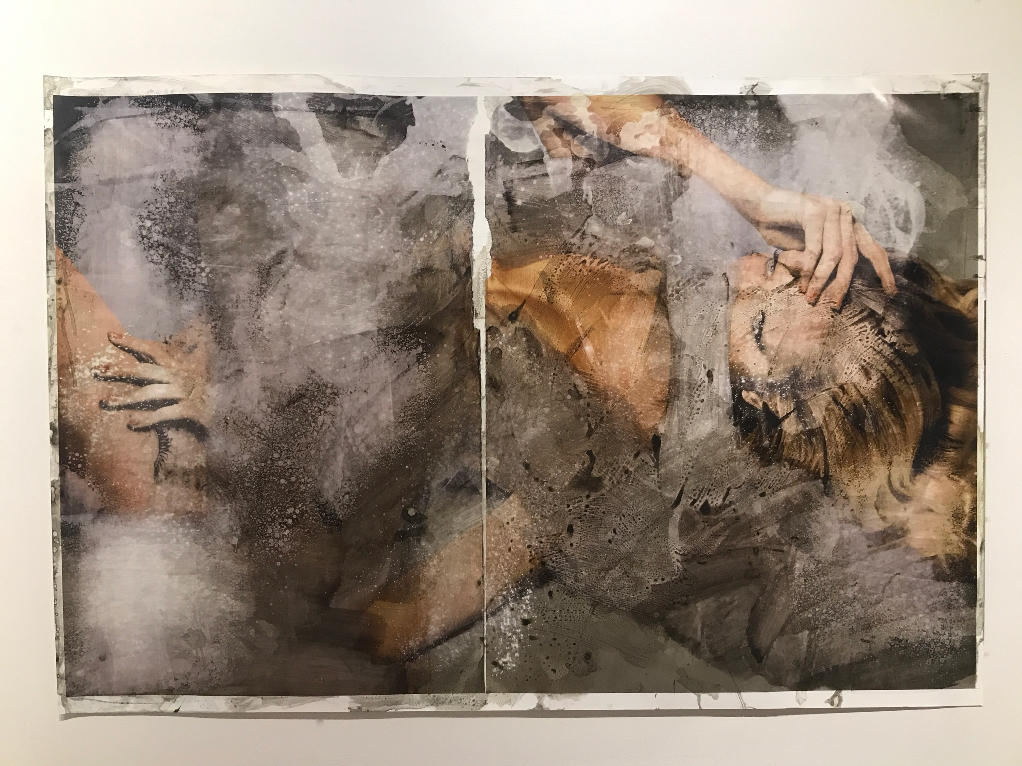 Eradication   2017  36 x 53 in.  Citra solv on magazine, nail polish remover, bleach, glass cleaner, and windex on photo paper
