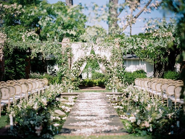 Amazed by the ingenious design of @joyproctor for this ceremony space at @belmondelencanto @camelliafloraldesign did an impeccable job of creating an enclosed feeling by stringing garland over the intimate ceremony space. You would almost never believe there is a full reflecting pond under the custom bridge and floral arrangements lining the aisle. @sparkcreativeevents provided the beautiful drapes adding that final touch along with the louvre cane back chairs from @thetentmerchant. A feat of whimsical beauty!⠀⠀⠀⠀⠀⠀⠀⠀⠀ @indiefilmlab⠀⠀⠀⠀⠀⠀⠀⠀⠀ @fujifilm_profilm⠀⠀⠀⠀⠀⠀⠀⠀⠀ .⠀⠀⠀⠀⠀⠀⠀⠀⠀ .⠀⠀⠀⠀⠀⠀⠀⠀⠀ .⠀⠀⠀⠀⠀⠀⠀⠀⠀ #joyproctordesign #indiefilmlab #longlivefilm #filmphotographer #weddingphotographer #losangelesweddingphotographer #destinationphotographer #destinationweddingphotographer #weddinginspo #weddinginspiration #styledshoot #topweddingphotographers #santabarbarawedding #santabarbaraweddingphotographer #luxurywedding #weddingdress #bride #italyweddingphotographer #hawaiiweddingphotographer #instawedding #weddingideas #bridal #engaged #romanticwedding #bride #fujiacros #fujifilm_profilm #santabarbaraportaitphotographer #laweddingphotographer #michaelandannacosta
