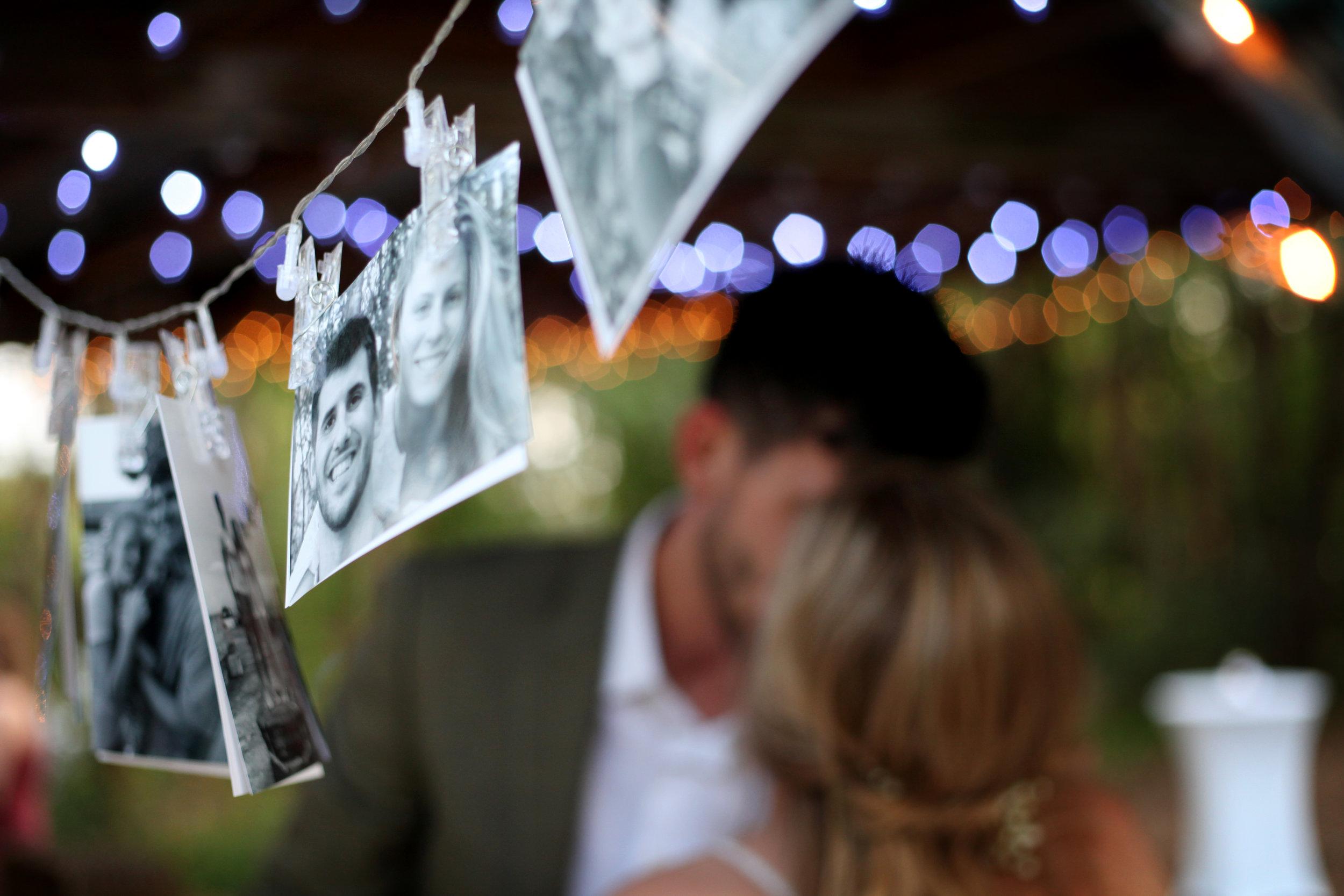 Kiss behind photos