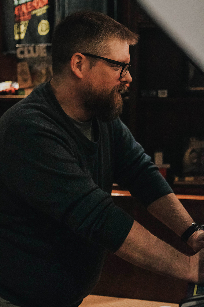 This is totally a real candid shot of Alan playing Dig Dug, and not a posed photo at all. But seriously - Dig Dug rules.