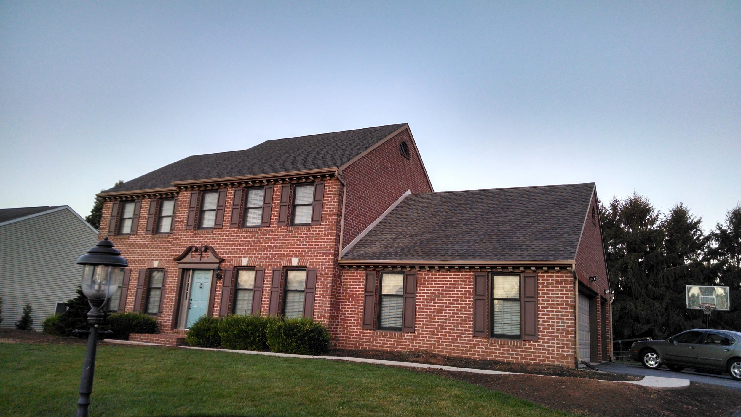 Replaced the old roof with a new GAF Timberline HD shingle. The color is weathered wood.