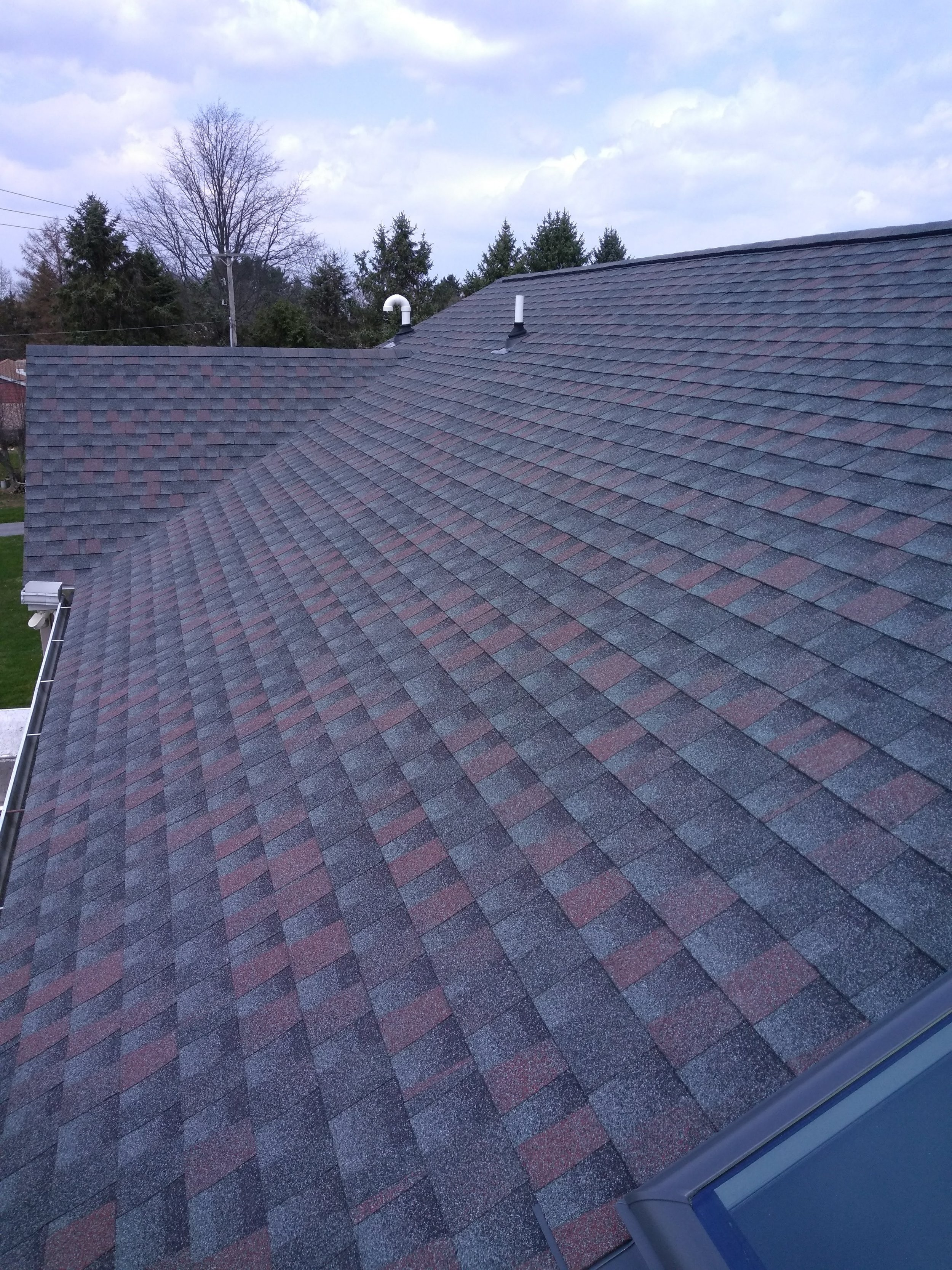 A new roof with GAF Timberline HD shingles. The color is Williamsburg Slate.