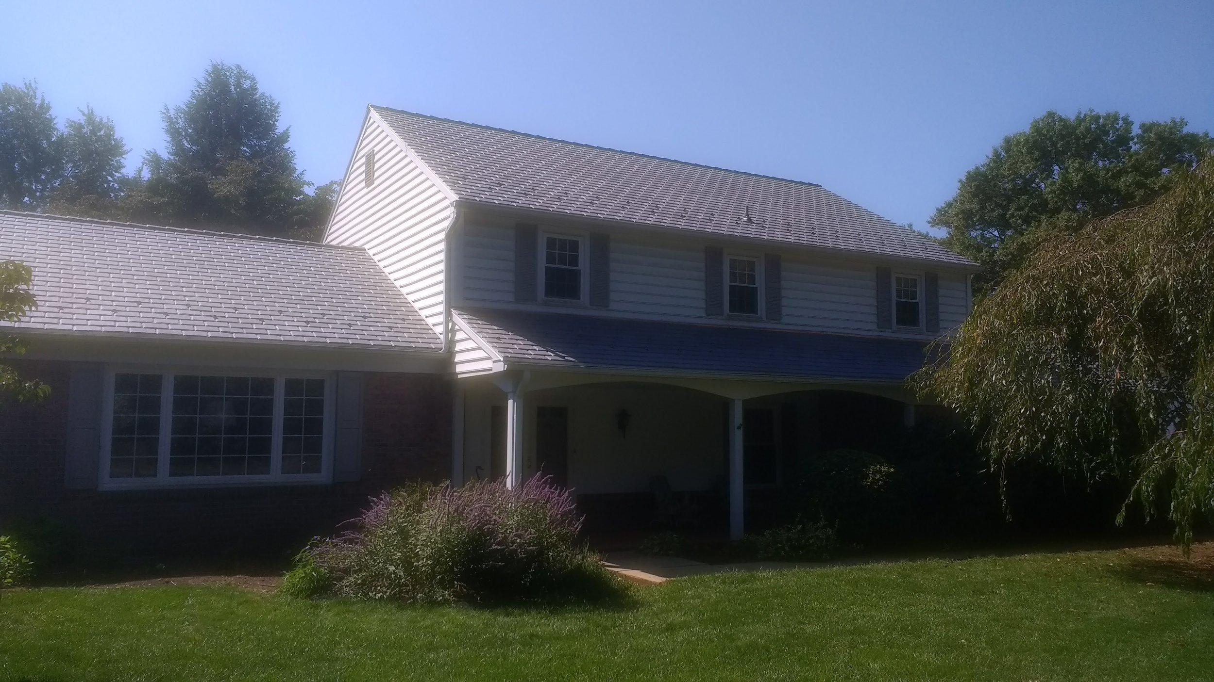 Replaced old cedar shakes with DaVinci Synthetic Slate.