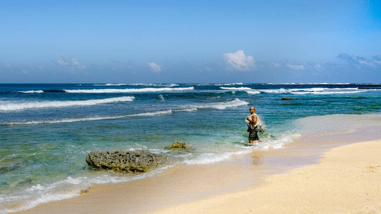 Fisherman at Waiakalua Beach
