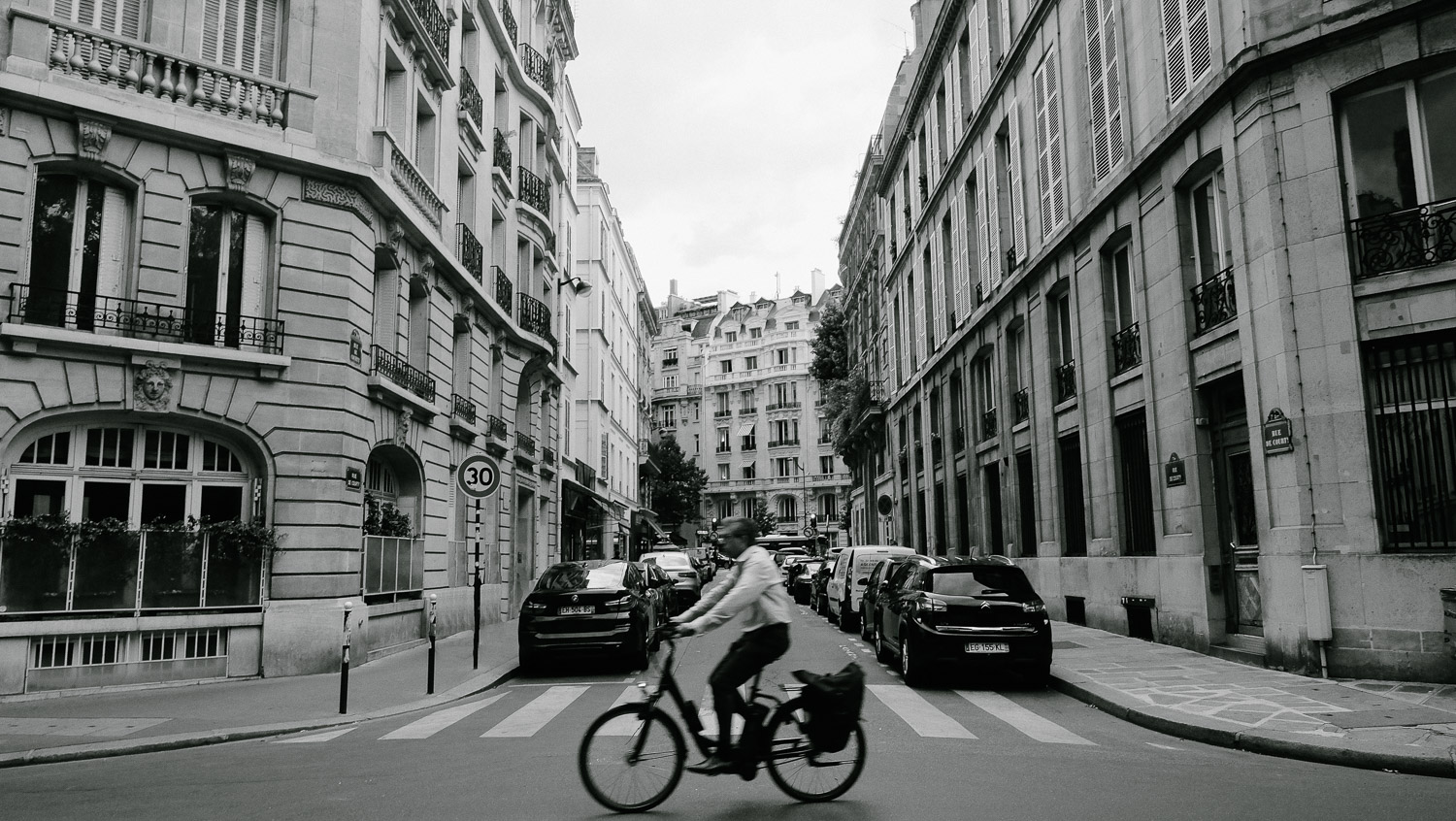 "A man rides his bike through the streets of Paris. Travel photography and guide by © Natasha Lequepeys for ""And Then I Met Yoko"". #paris #paristravel #photoblog #travelguide #france #parisitinerary #parishighlights #parissights #travelblog #travelphotography #landscapephotography #travelitinerary #fujifilm #paristravelguide #architecturephotography #europe #travelblogger #wanderlust #explore #travel"