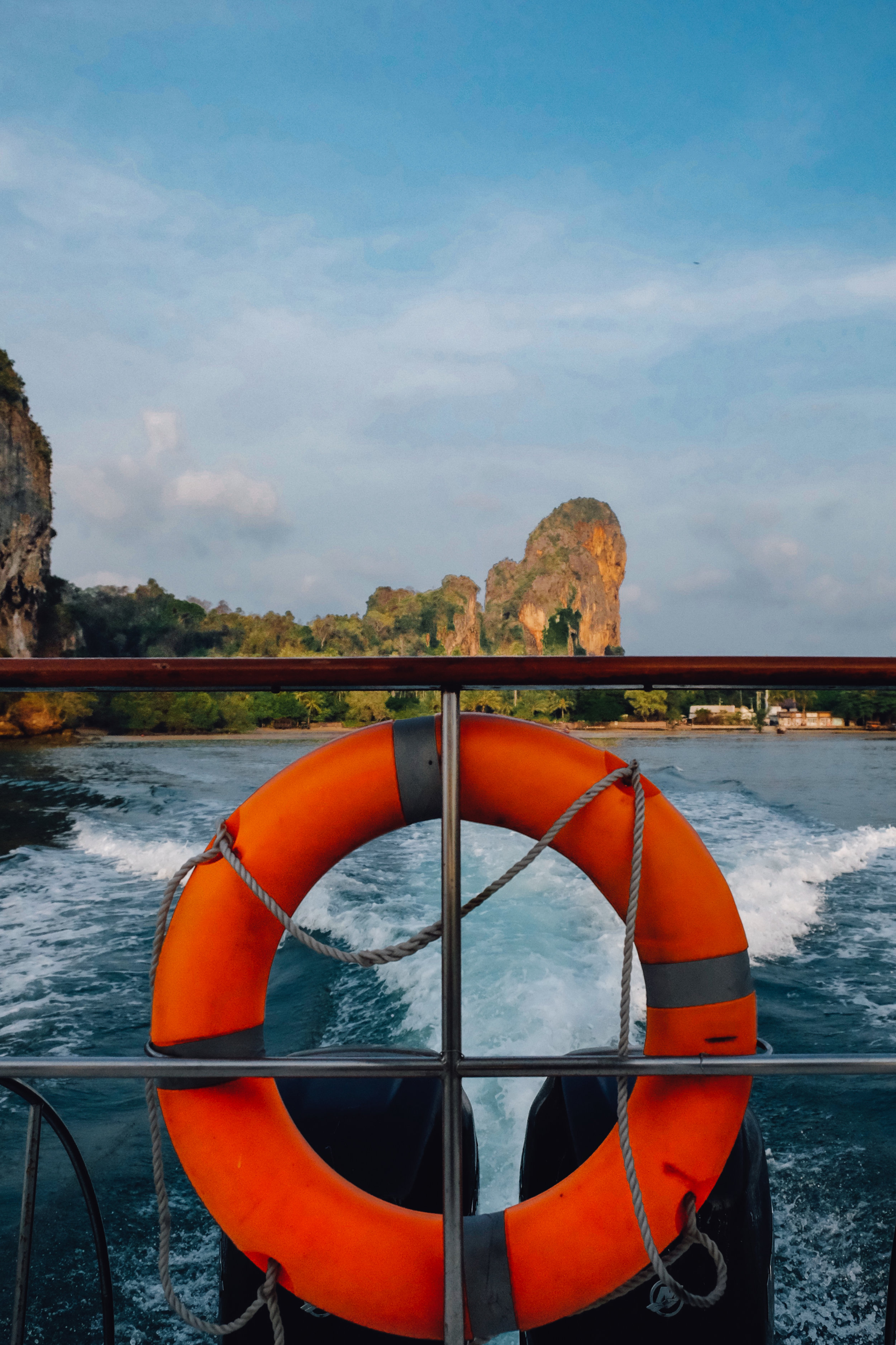 """View from the back of the boat when leaving the Rayavadee Resort in Krabi. Travel photography and guide by © Natasha Lequepeys for """"And Then I Met Yoko"""". #thailand #seasia #travelguide #photoblog #travelblog #travelphotography #landscapephotography #travelitinerary #fujifilm #krabi #beachvacation #honeymoon #boat #rayavadee #resort #luxury #luxurytravel #spa #travelblogger #travel"""