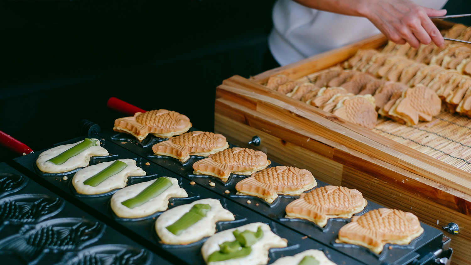 Taiyaki is a fish-shaped waffle filled with custards. A popular street dessert in Japan - just follow your nose.