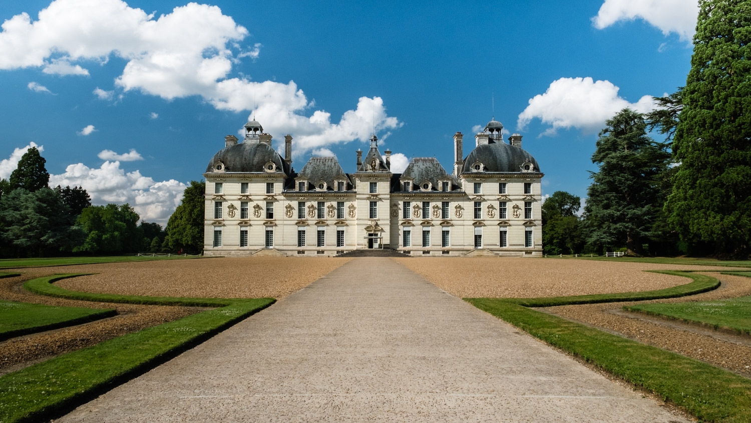 "Front view of the Château de Cheverny - Travel photography and guide by © Natasha Lequepeys for ""And Then I Met Yoko"". #loirevalley #france #travelguide #travelphotography #valdeloire"
