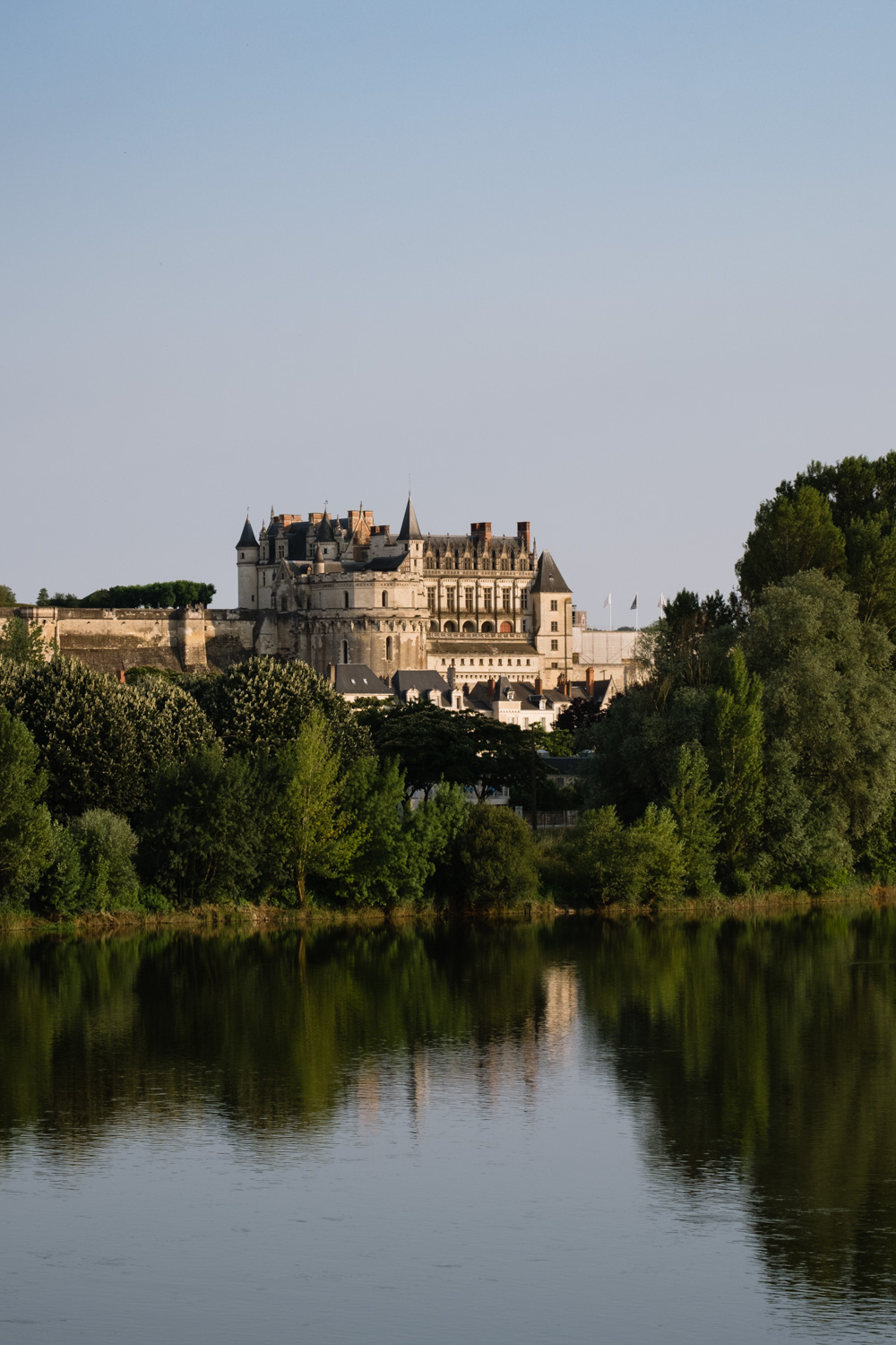 "Château d'Amboise from across the Loire River. Travel photography and guide by © Natasha Lequepeys for ""And Then I Met Yoko"". #loirevalley #france #travelguide #photoblog #travelblog #travelphotography #landscapephotography #architecturephotography #travelitinerary #fujifilm #valdeloire #loire #chambord #chenonceau #cheverny #chaumont #chateau #castles #discoverfrance #honeymoondestination"