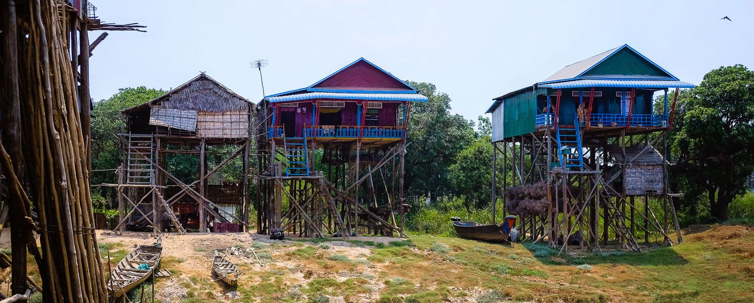 """Stilt houses during dry season in the backcountry, Siem Reap- travel photography and guide by © Natasha Lequepeys for """"And Then I Met Yoko"""". #siemreap #angkorwat #taprohm #travelguide #travelblog #travelitinerary #itinerary #siemreapitinerary #seasia #cambodia #travelcambodia #travelsiemreap #photoblog #travelblogger #travelphotography #landscapephotography #fujifilm #temples #siemreapprivatetour #atv"""