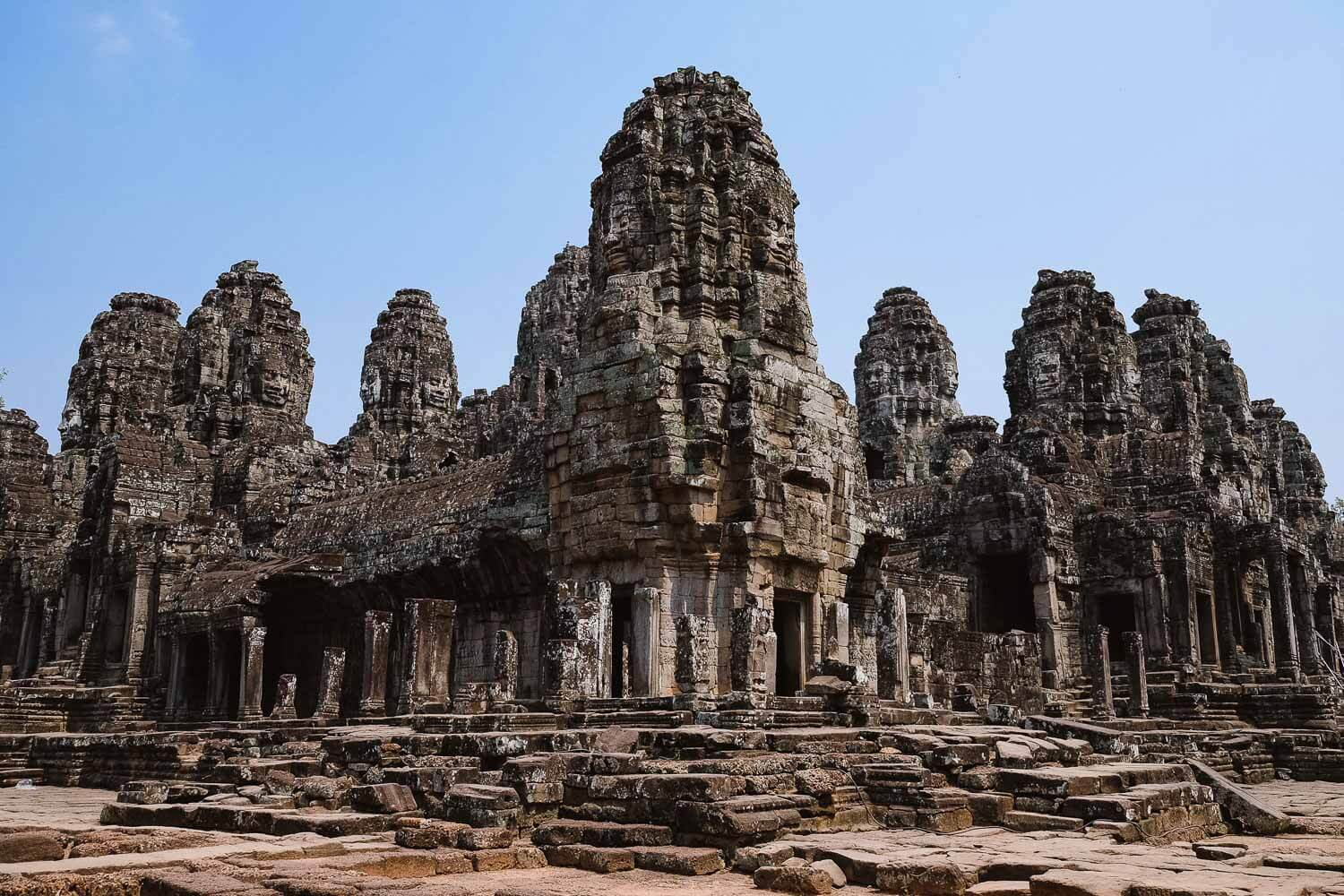 """The Temple of Bayon is known for the buddha faces in the wall peaks, Siem Reap. Travel photography and guide by © Natasha Lequepeys for """"And Then I Met Yoko"""". #siemreap #angkorwat #templebayon #travelguide #travelblog #travelitinerary #itinerary #siemreapitinerary #seasia #cambodia #travelcambodia #travelsiemreap #photoblog #travelblogger #travelphotography #landscapephotography #fujifilm #temples #siemreapprivatetour #atv"""