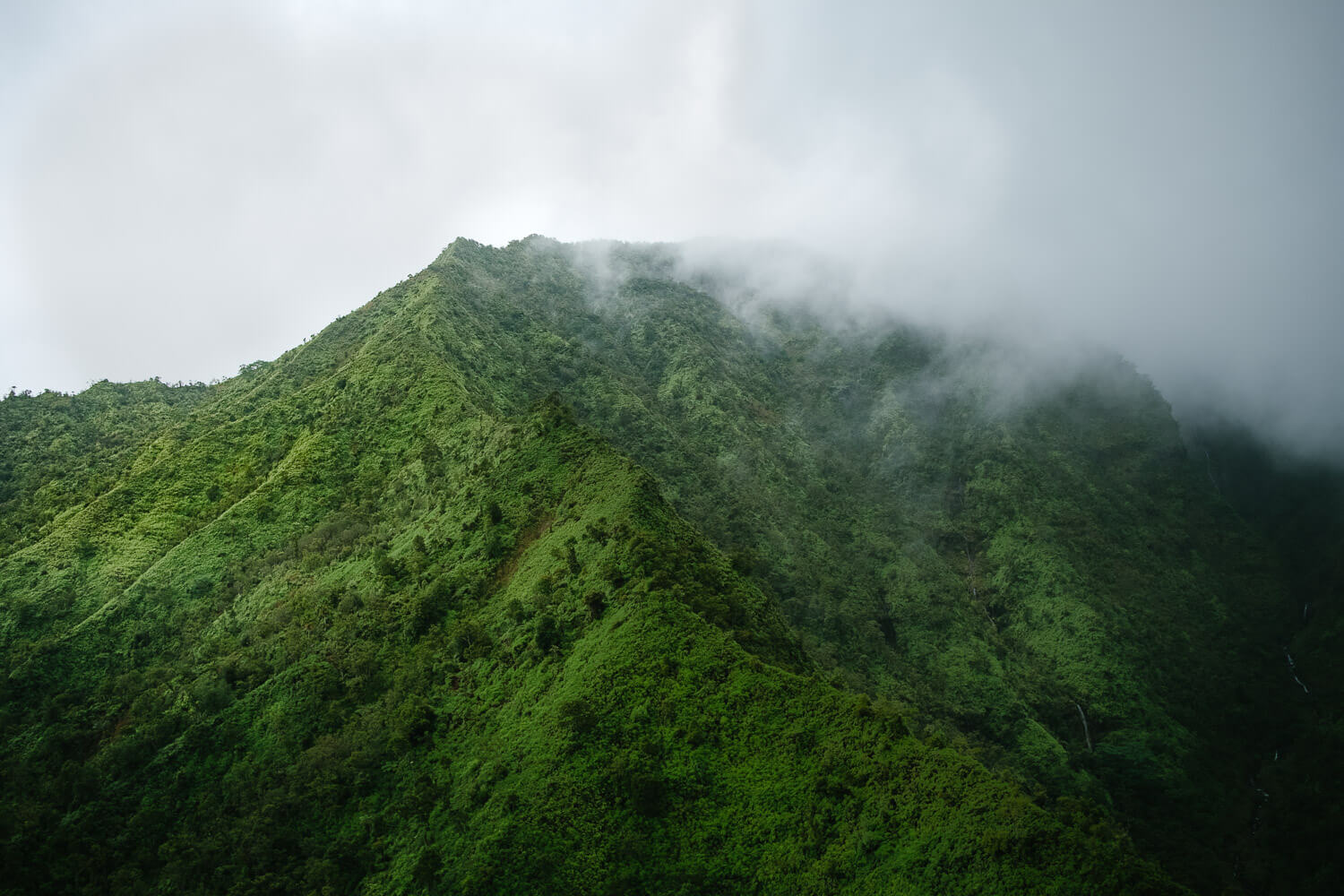 """Misty clouds in Kauai. Travel photography and guide by © Natasha Lequepeys for """"And Then I Met Yoko"""". #hawaii #travelguide #photoblog #travelblog #landscapephotography #fujifilm"""