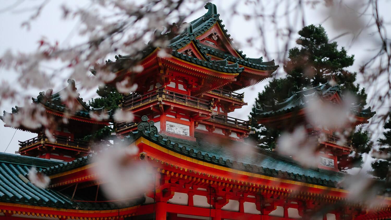 "Spend 10 days exploring Tokyo, Kyoto, Osaka and Nara with this travel guide to Japan. (Heian Jingu Shrine temple in Kyoto). Travel photography and guide by © Natasha Lequepeys for ""And Then I Met Yoko"". #japan #japanitinerary #tokyo #osaka #travelblog #travelphotography #landscapephotography #travelitinerary #fujifilm #kyoto #nara #oaska #travelguide #asia #foodphotography #japantravel #japanfood #ryokan #cherryblossom #springtravel"