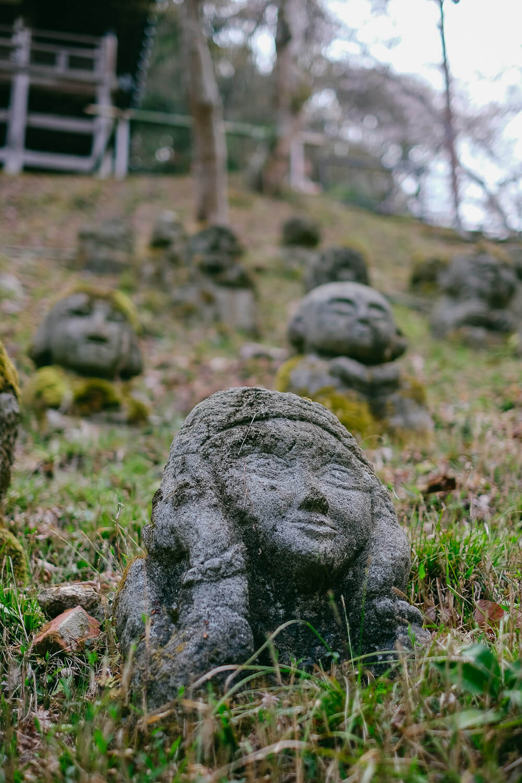 "One reflective buddha at Otagi Nenbutsu-Ji, Kyoto. Travel photography and guide by © Natasha Lequepeys for ""And Then I Met Yoko"". #japan #japanitinerary #travelblog #fujifilm #asia"