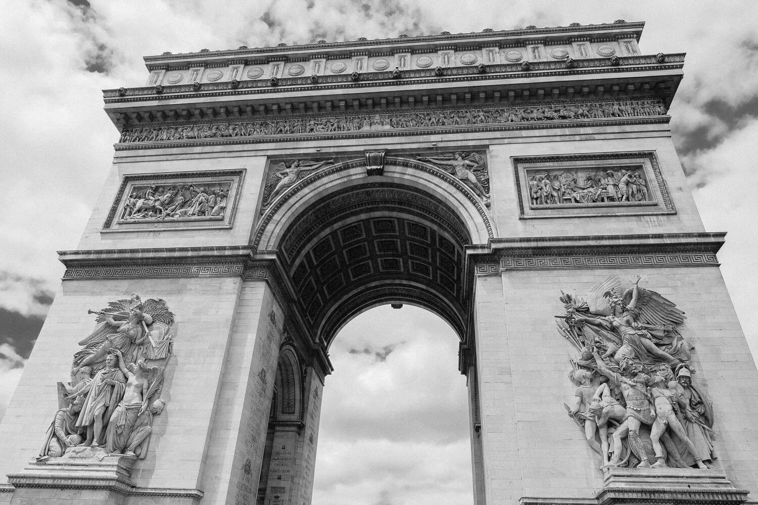 "The Arc de Triomphe in Paris. Travel photography and guide by © Natasha Lequepeys for ""And Then I Met Yoko"". #paris #paristravel #photoblog #travelguide #france #parisitinerary #parishighlights #parissights #travelblog #travelphotography #landscapephotography #travelitinerary #fujifilm #paristravelguide #architecturephotography #europe #travelblogger #wanderlust #explore #travel"