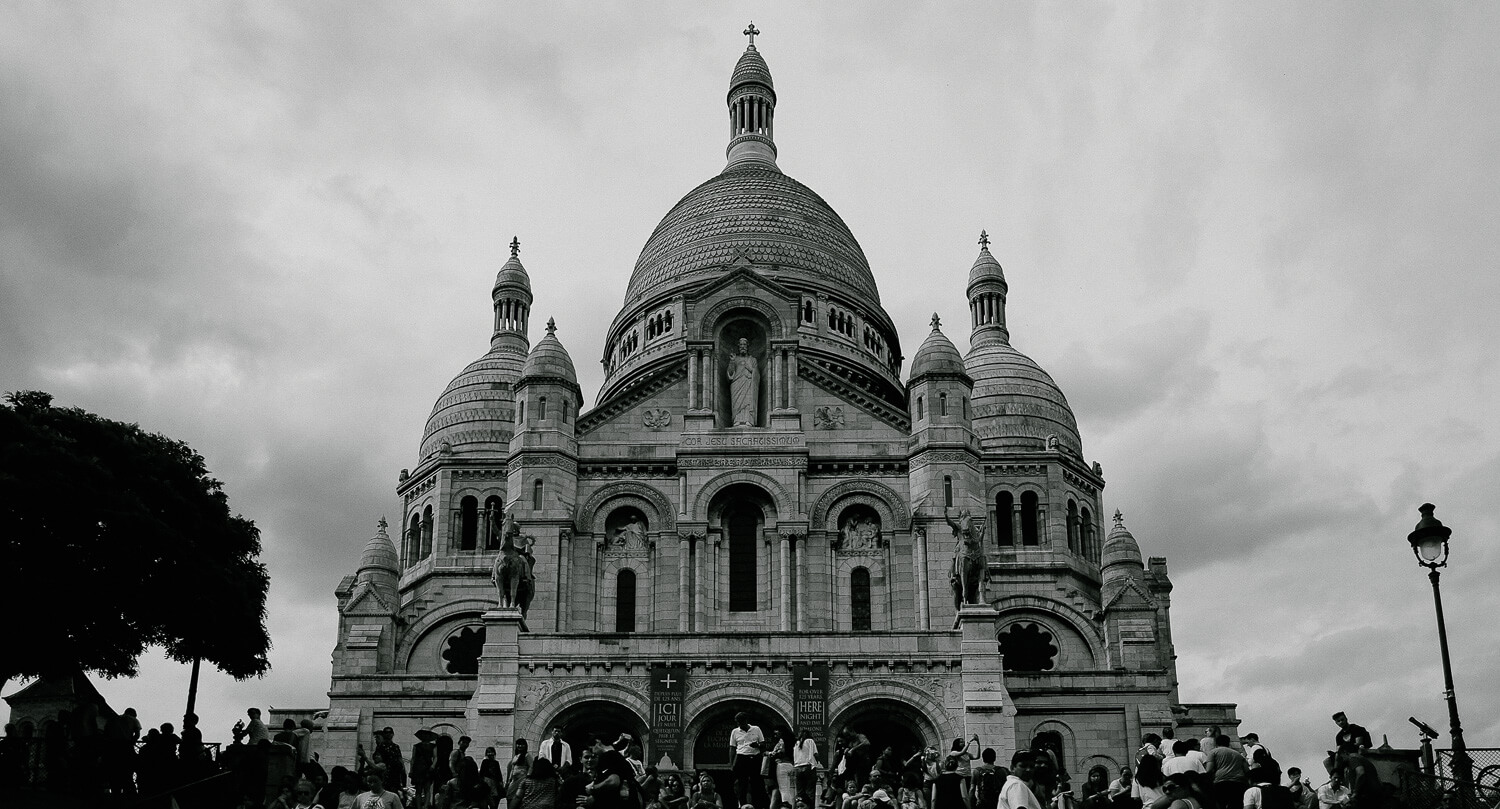 "Sacré-Cœur Basilica in Montmartre, Paris. Travel photography and guide by © Natasha Lequepeys for ""And Then I Met Yoko"". #paristravel #photoblog #travelguide #france #parisitinerary"