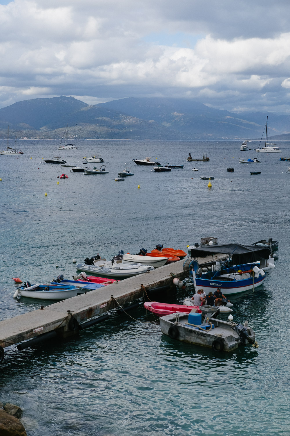 A dock with boats in Campomoro, Corsica