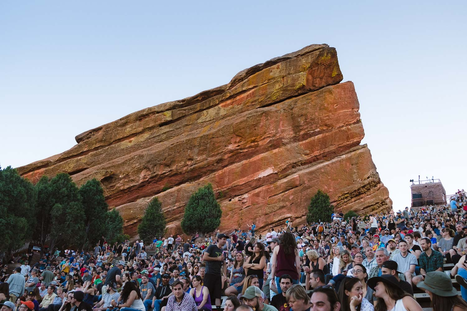 """Thousands of people wait for the concert to start at the Red Rocks Amphitheatre, Denver. Travel photography and guide by © Natasha Lequepeys for """"And Then I Met Yoko"""". #colorado #usa #denver #rockymountainnationalpark #rmnp #coloradosprings #travelguide #photoblog #travelblog #travelphotography #landscapephotography #coloradoitinerary #fujifilm #hiking #nature #wildlifephotography #getoutdoors #deer #nationalpark #gardenofgods"""