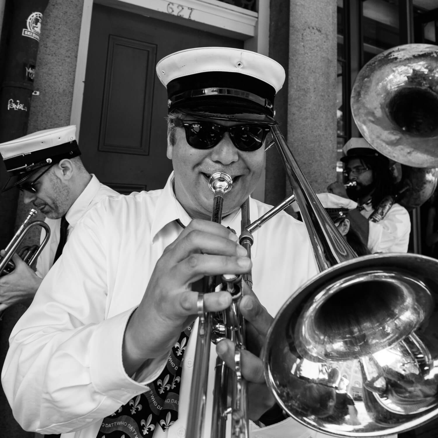 """Trombone player in a second line - Travel photography and guide by © Natasha Lequepeys for """"And Then I Met Yoko"""". #neworleans #nola #photoblog #streetphotography #travelitinerary #fujifilm"""