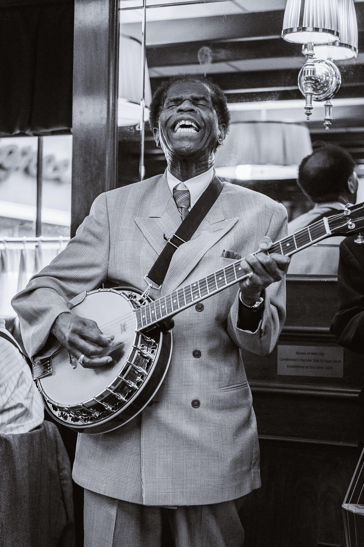 "Mr. Joe Cushenberry performing at Mr. B's Bistro. Travel photography and guide by © Natasha Lequepeys for ""And Then I Met Yoko"". #neworleans #nola #travelguide #photoblog #travelblog #travelphotography #travelitinerary #fujifilm #usa #visitnola #weekendgetaway #travel #neworleans3dayitinerary #streetphotography #bnw #jazz #music #banjo #jazzbrunch #blackandwhitephotography"
