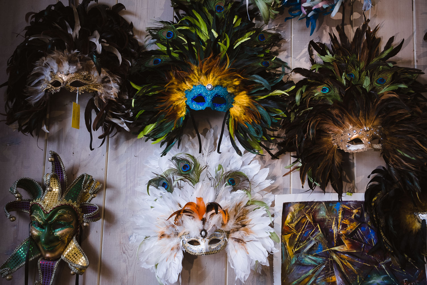 """""""Crescent City Mask Co."""" - Specializing in handmade feather masks. Address: 332 Chartres St."""