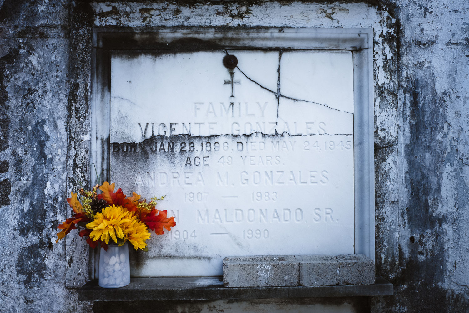 """A tombstone in St. Louis Cemetery No.1 - Travel photography and guide by © Natasha Lequepeys for """"And Then I Met Yoko"""". #neworleans #nola #photoblog #travelitinerary #fujifilm #cemetery"""