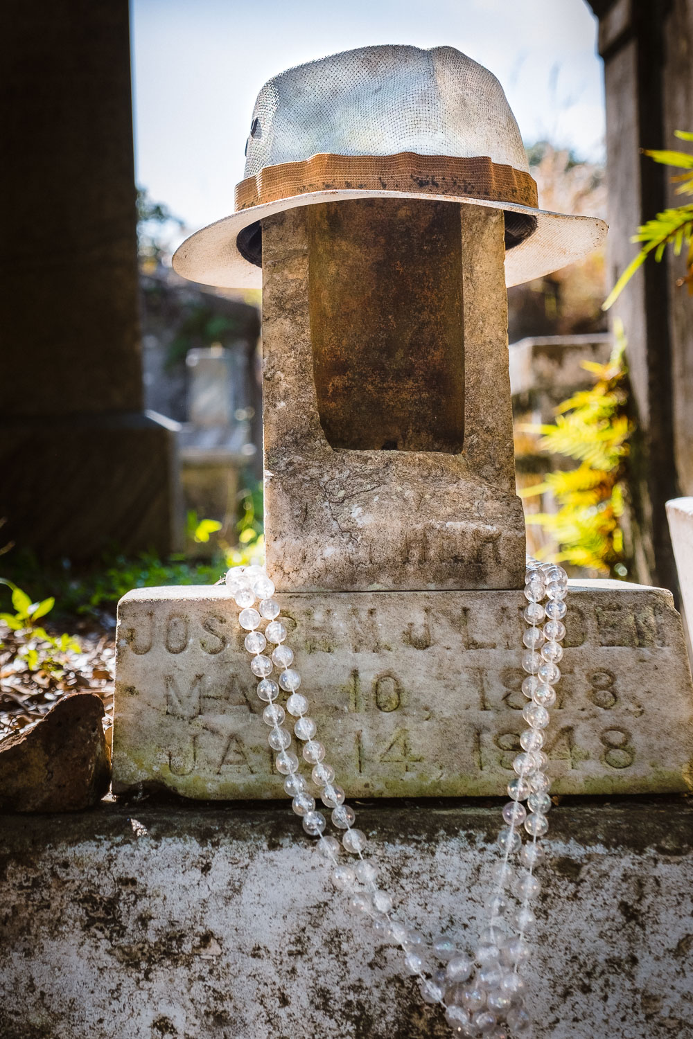 """A tombstone in Lafayette Cemetery - Travel photography and guide by © Natasha Lequepeys for """"And Then I Met Yoko"""". #neworleans #nola #photoblog #travelitinerary #fujifilm #cemetery"""