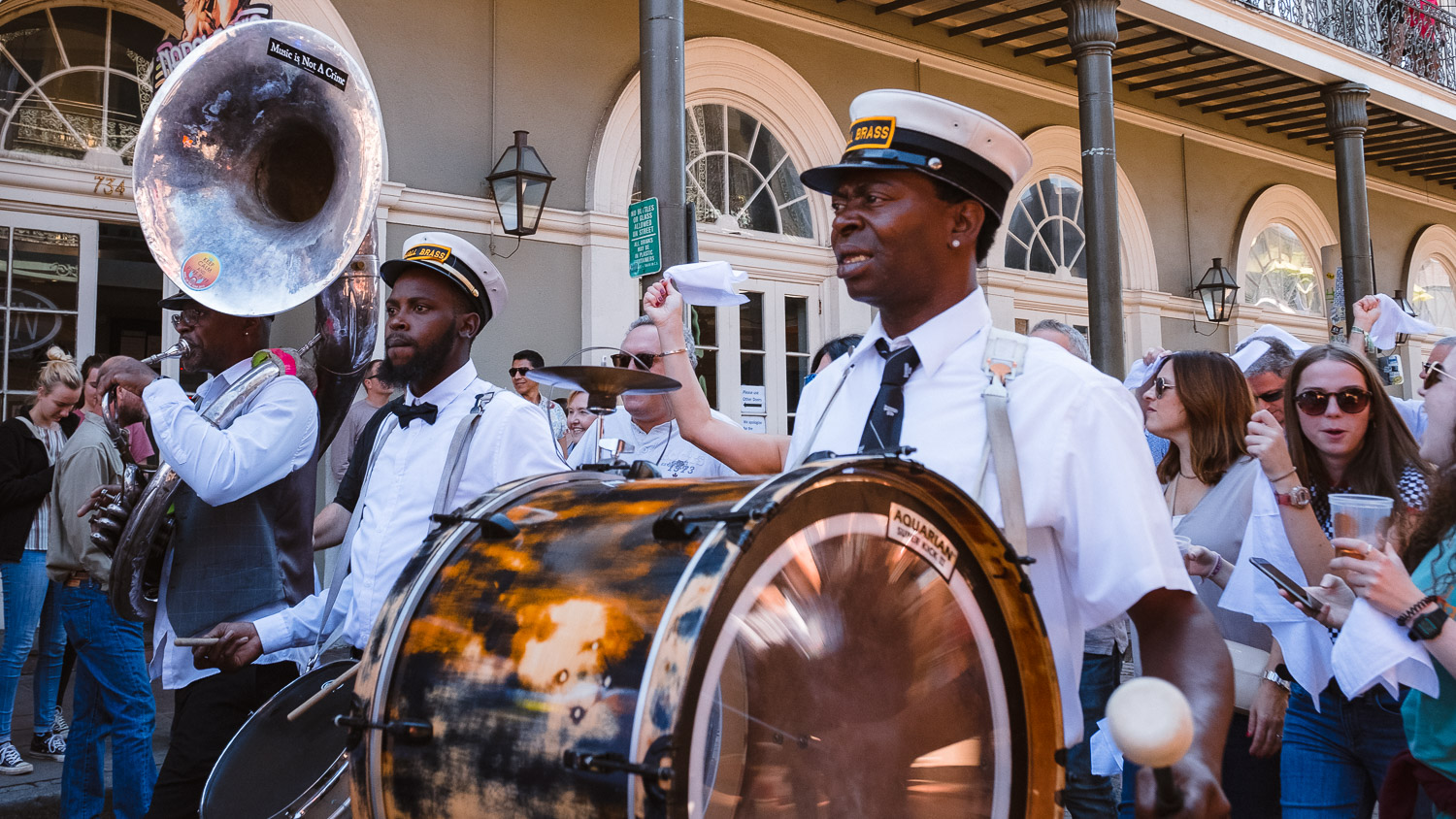 """A second line on Bourbon Street. Travel photography and guide by © Natasha Lequepeys for """"And Then I Met Yoko"""". #neworleans #nola #travelguide #photoblog #travelblog #travelphotography #travelitinerary #fujifilm #usa #visitnola #weekendgetaway #travel #neworleans3dayitinerary #streetphotography #secondline #jazz #music #celebrate #parade #bourbonstreet"""