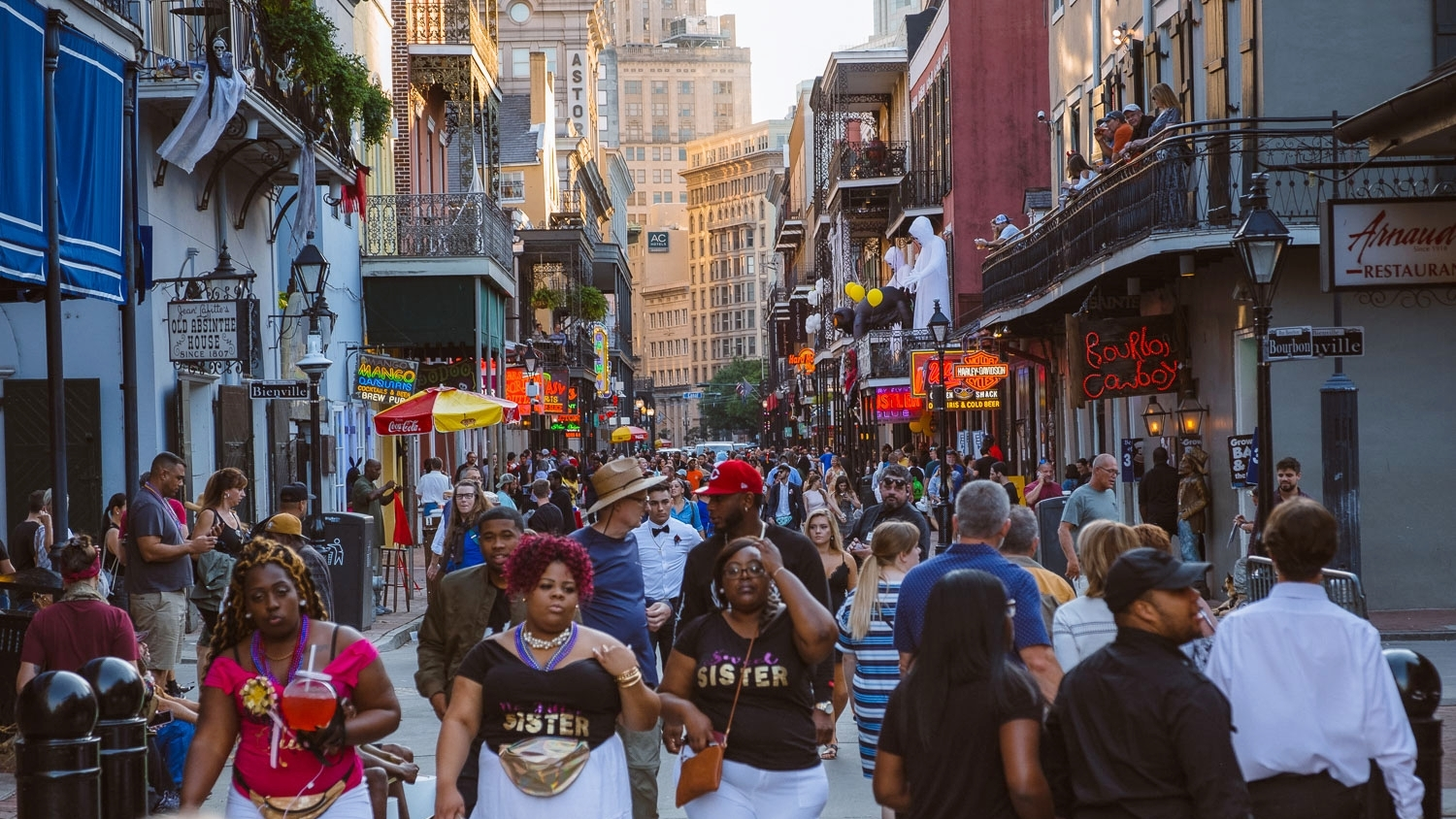 """Bourbon Street during golden hour, New Orleans. Travel photography and guide by © Natasha Lequepeys for """"And Then I Met Yoko"""". #neworleans #nola #travelguide #photoblog #travelblog #travelphotography #travelitinerary #fujifilm #usa #visitnola #weekendgetaway #travel #neworleans3dayitinerary #bourbonstreet #streetphotography #city #urban #touristattraction #goldenhour #streetparty"""