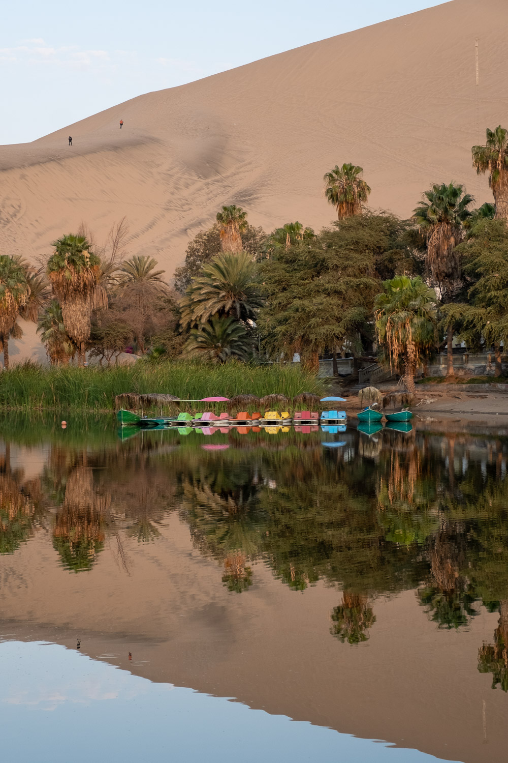 "Huacachina oasis, Ica, Peru. Travel photography and guide by © Natasha Lequepeys for ""And Then I Met Yoko"". #photoblog #travelblog #landscapephotography #fujifilm #blogger #reflection"