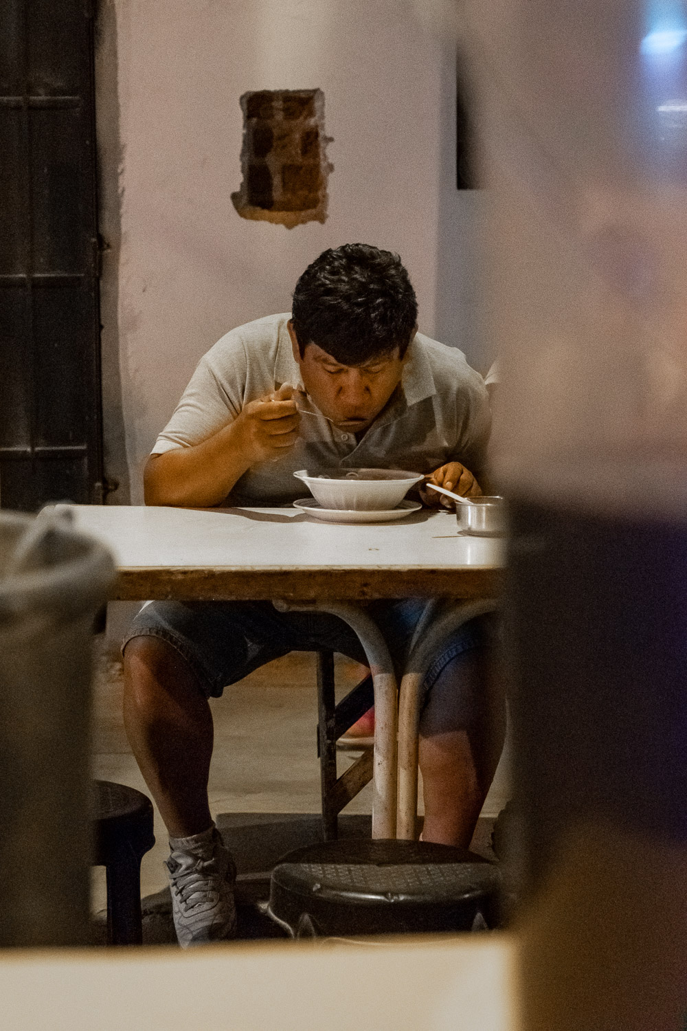"Man eats his soup in Ica, Peru. Travel photography and guide by © Natasha Lequepeys for ""And Then I Met Yoko"". #huacachina #photoblog #travelblog #streetfood #fujifilm #blogger"