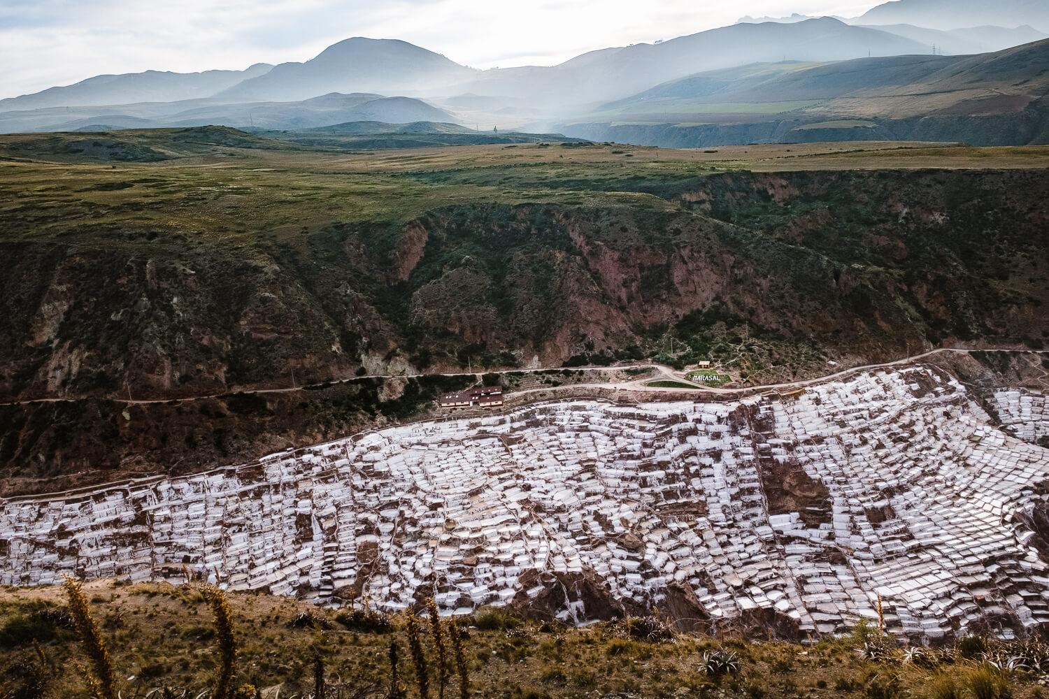 """The Maras Salt Ponds in The Sacred Valley, Peru. Travel photography and guide by © Natasha Lequepeys for """"And Then I Met Yoko"""". #peru #travelblog #fujifilm"""