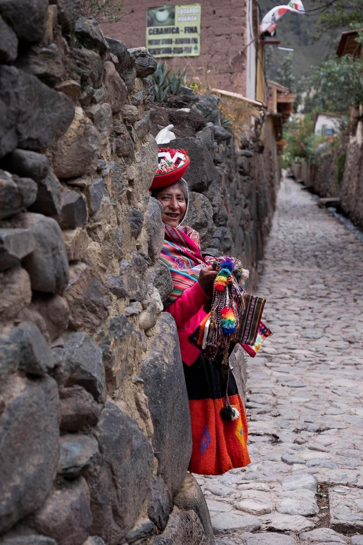 "A woman selling trinkets in Ollantaytambo, The Sacred Valley, Peru. Travel photography and guide by © Natasha Lequepeys for ""And Then I Met Yoko"". #sacredvalley #peru #travelguide #photoblog #travelblog #travelphotography #streetphotography #travelitinerary #fujifilm #southamerica #visitperu #culture #incasights #machupicchu #ollantaytambo #candid #peruvianwoman #ValleSagrado #travel #people"