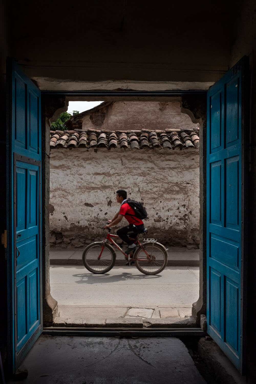 "Man riding his bike, The Sacred Valley, Peru. Travel photography and guide by © Natasha Lequepeys for ""And Then I Met Yoko"". #photoblog #fujifilm #ValleSagrado"