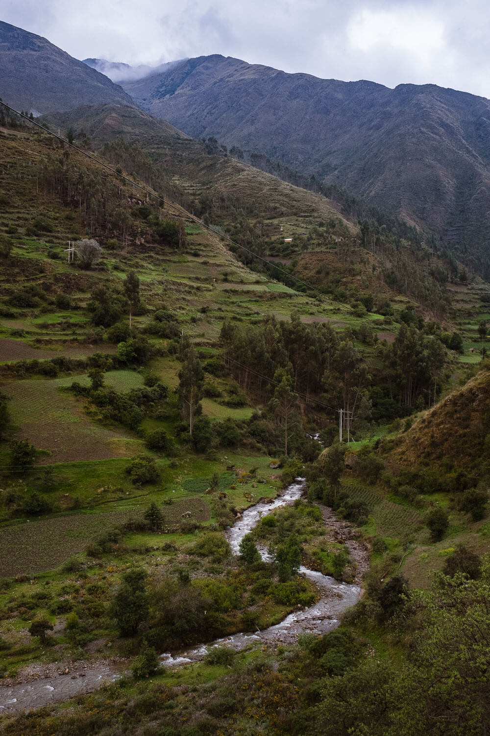 """The Sacred Valley, Peru. Travel photography and guide by © Natasha Lequepeys for """"And Then I Met Yoko"""". #peru #sacredvalley #patacancha #photoblog #travelblog #travelphotography #landscapephotography #travelitinerary #fujifilm #river #tradition #culture #nature #andes #village #valley #cusco #ollantaytambo #travel #travelperu"""