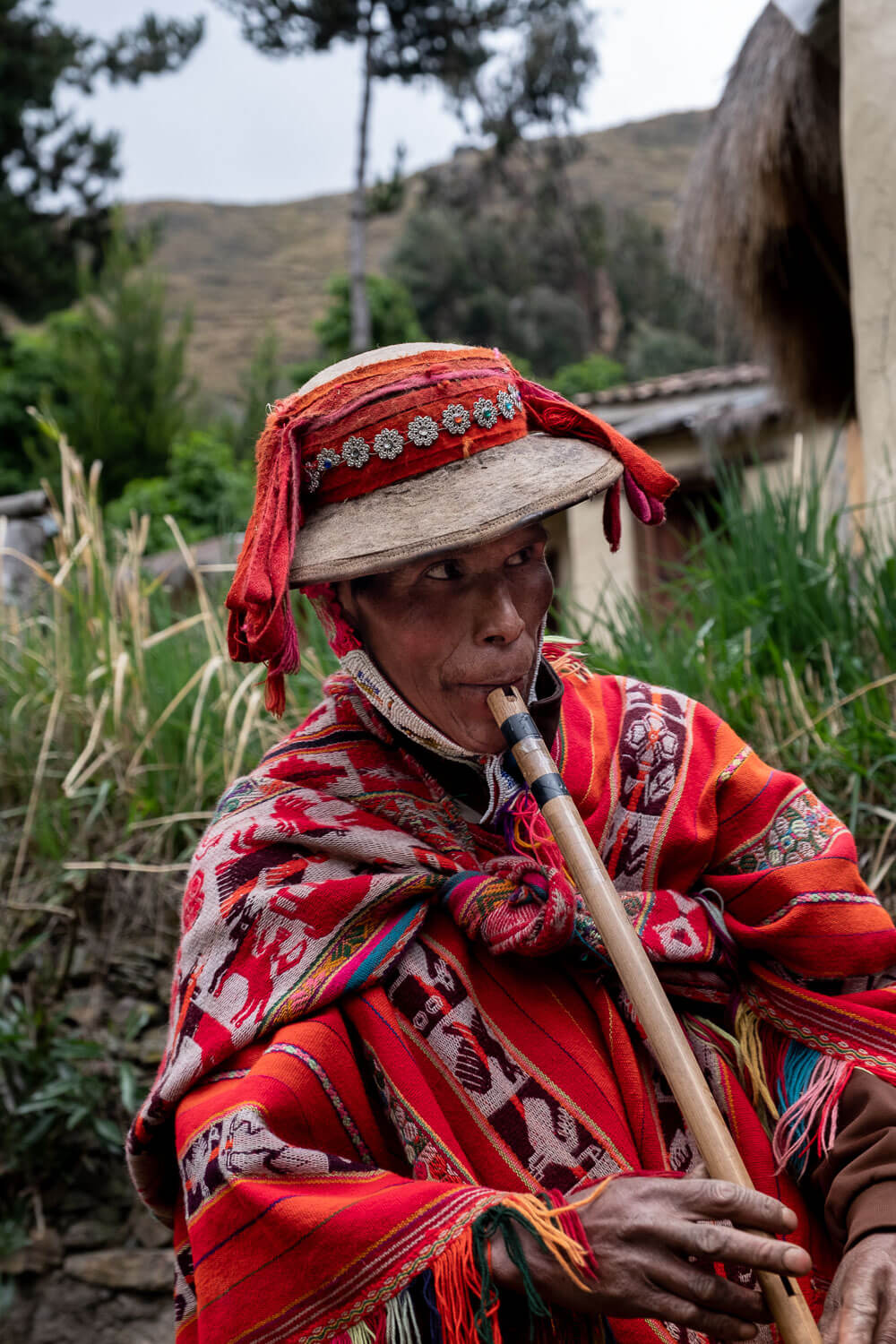 """Learn about the ancient weaving techniques that create beautiful Peruvian garments. The weavers of Patacancha, The Sacred Valley, Peru. Travel photography and guide by © Natasha Lequepeys for """"And Then I Met Yoko"""". #peru #sacredvalley #patacancha #photoblog #travelblog #travelphotography #portraitphotography #travelitinerary #fujifilm #weaving #tradition #culture #people #andes #village #weavingdemonstration #cusco #ollantaytambo #travel #travelperu"""