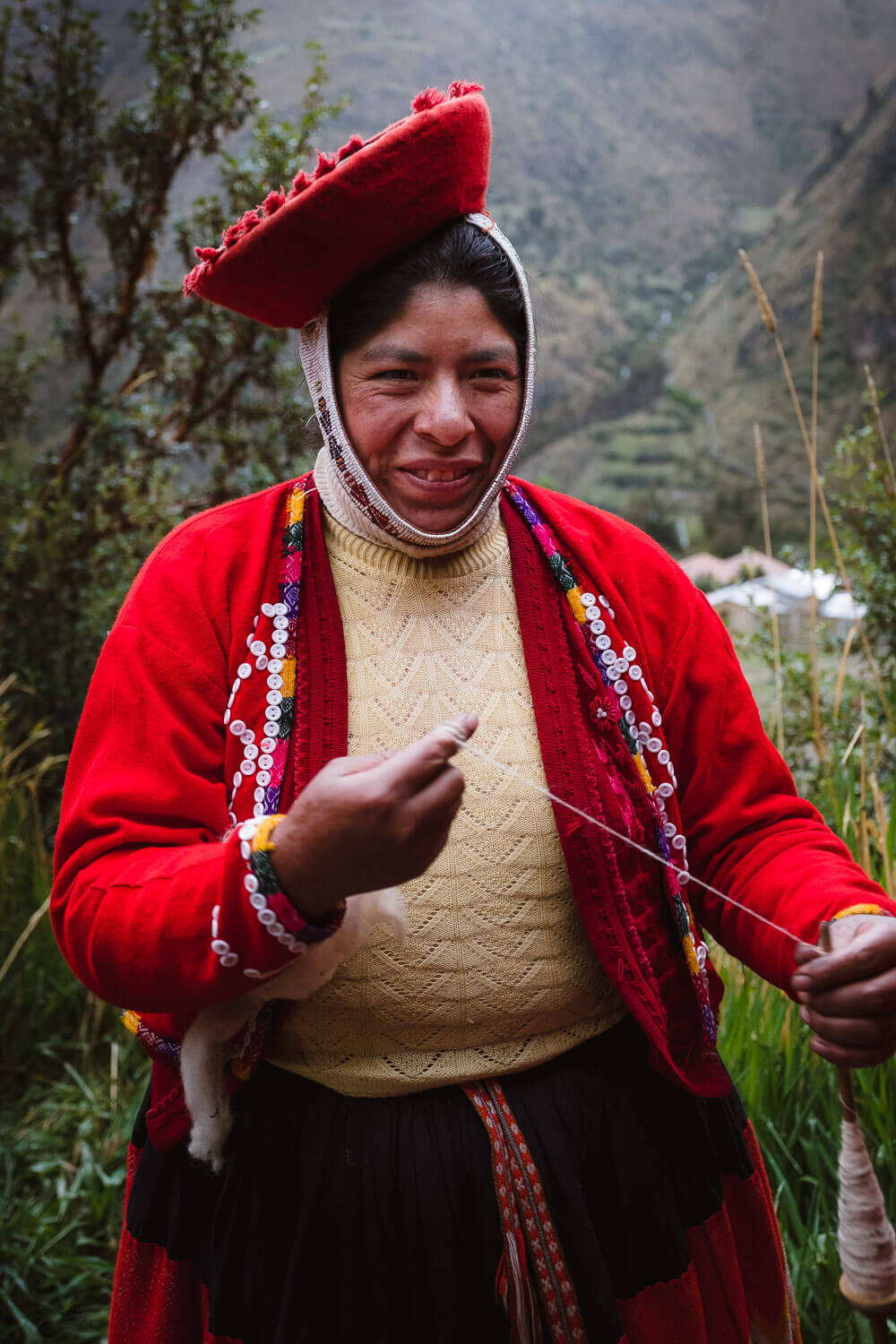 """A weaver shows us the spinning technique to create yarn. The weavers of Patacancha, The Sacred Valley, Peru. Travel photography and guide by © Natasha Lequepeys for """"And Then I Met Yoko"""". #peru #sacredvalley #patacancha #photoblog #travelblog #travelphotography #portraitphotography #travelitinerary #fujifilm #weaving #tradition #culture #people #andes #village #weavingdemonstration #cusco #ollantaytambo #travel #travelperu"""