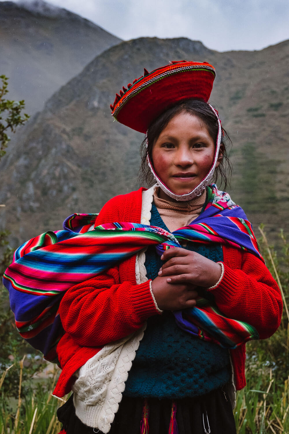"""The young daughter who has already mastered many weaving skills. The weavers of Patacancha, The Sacred Valley, Peru. Travel photography and guide by © Natasha Lequepeys for """"And Then I Met Yoko"""". #peru #sacredvalley #patacancha #photoblog #travelblog #travelphotography #portraitphotography #travelitinerary #fujifilm #weaving #tradition #culture #people #andes #village #weavingdemonstration #cusco #ollantaytambo #travel #travelperu"""