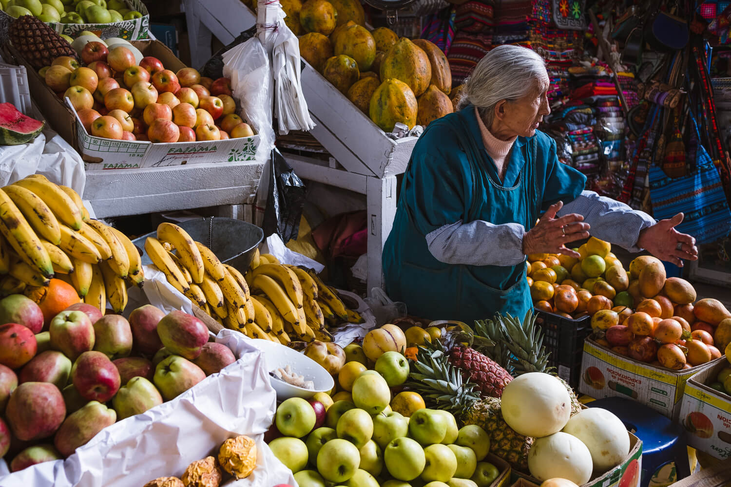 """Woman selling fruit in the San Pedro Market, Cusco. Travel photography and guide by © Natasha Lequepeys for """"And Then I Met Yoko"""". #cusco #peru #photoblog #travelblog #peruitinerary #cuscoitinerary"""