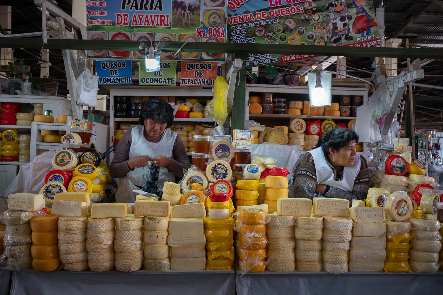 """Women selling cheese in the San Pedro Market, Cusco. Travel photography and guide by © Natasha Lequepeys for """"And Then I Met Yoko"""". #cusco #peru #photoblog #travelblog #peruitinerary #cuscoitinerary"""