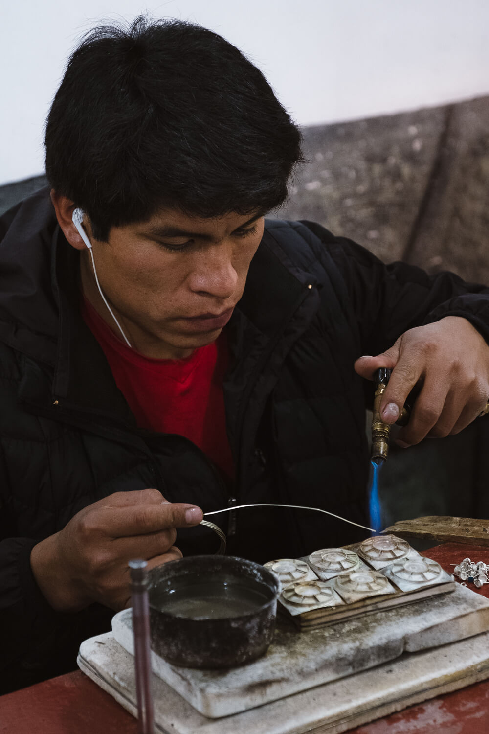 """Man makes silver jewelry at the Pisac Market, Cusco. Travel photography and guide by © Natasha Lequepeys for """"And Then I Met Yoko"""". #cusco #peru #photoblog #travelblog #peruitinerary #cuscoitinerary"""