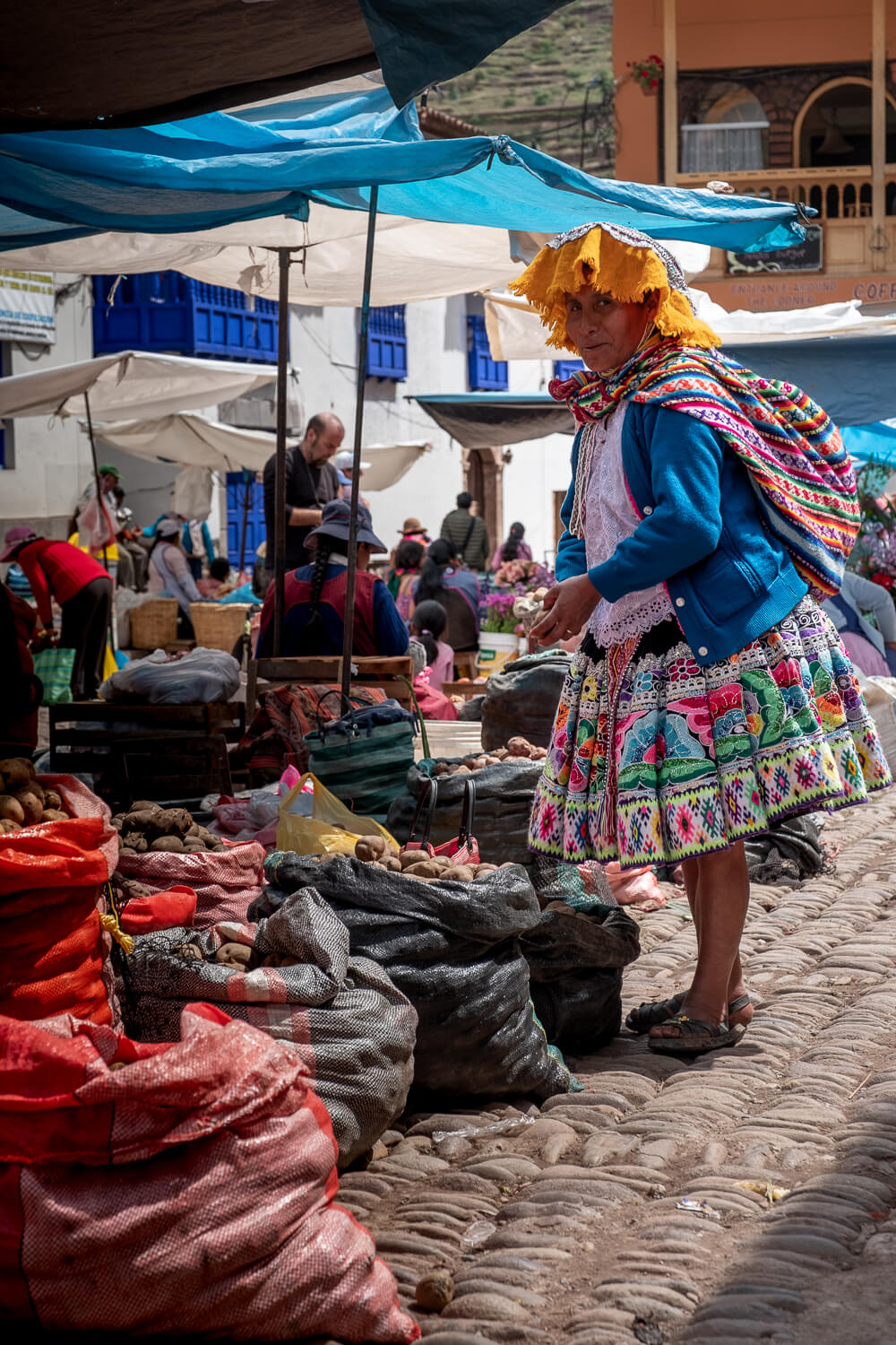 """Woman sells potatoes at the Pisac Market, Cusco. Travel photography and guide by © Natasha Lequepeys for """"And Then I Met Yoko"""". #cusco #peru #photoblog #travelblog #peruitinerary #cuscoitinerary"""