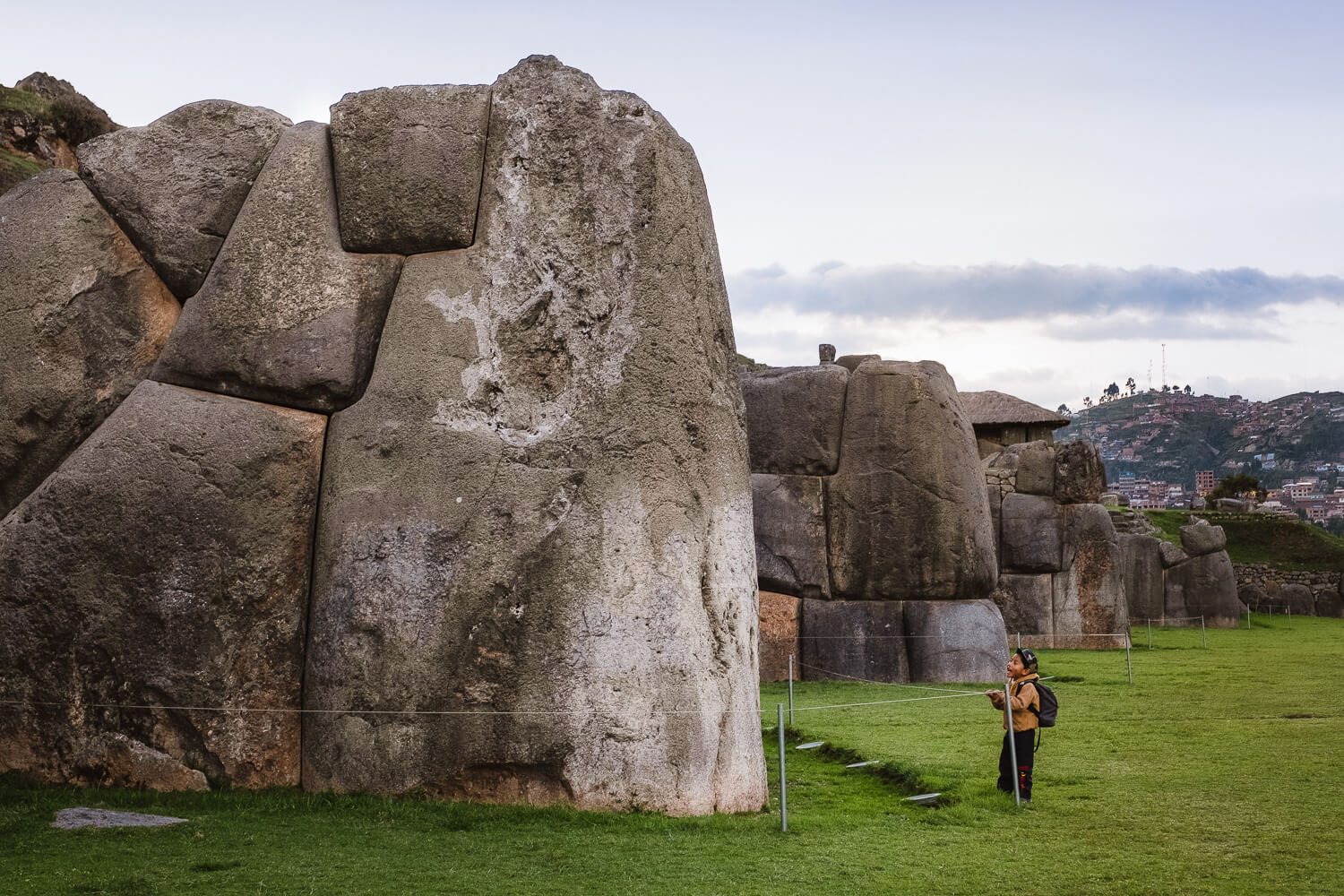 """Child looking at the structure of Saqsaywaman, Cusco. Travel photography and guide by © Natasha Lequepeys for """"And Then I Met Yoko"""". #cusco #peru #photoblog #travelblog #peruitinerary #cuscoitinerary"""