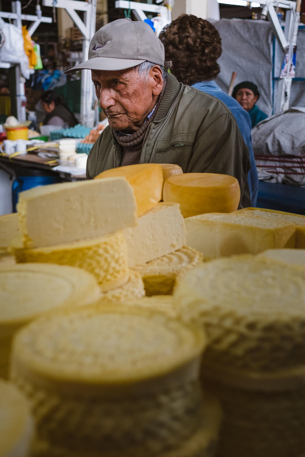 """Man buying cheese in the San Pedro Market, Cusco. Travel photography and guide by © Natasha Lequepeys for """"And Then I Met Yoko"""". #cusco #peru #photoblog #travelblog #peruitinerary #cuscoitinerary"""