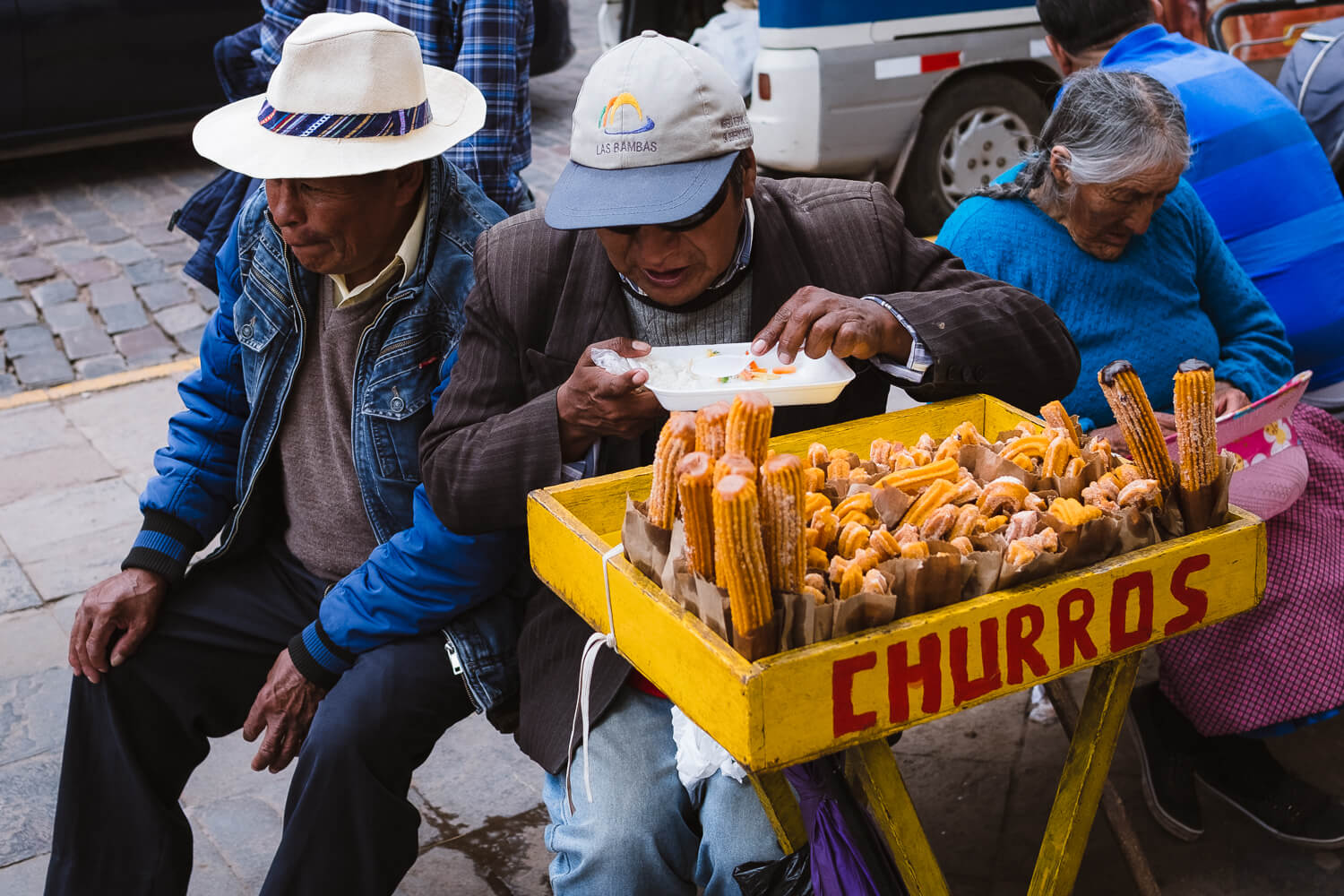 """Men selling churros, Cusco. Travel photography and guide by © Natasha Lequepeys for """"And Then I Met Yoko"""". #cusco #peru #photoblog #travelblog #peruitinerary #cuscoitinerary"""