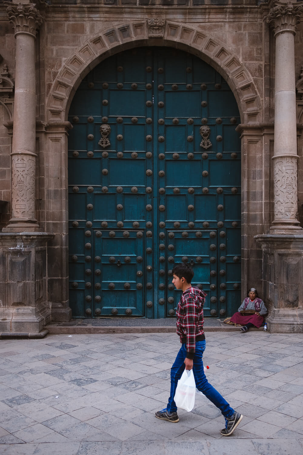 """Boy walking by the Cusco Cathedral, Cusco. Travel photography and guide by © Natasha Lequepeys for """"And Then I Met Yoko"""". #cusco #peru #photoblog #travelblog #peruitinerary #cuscoitinerary"""