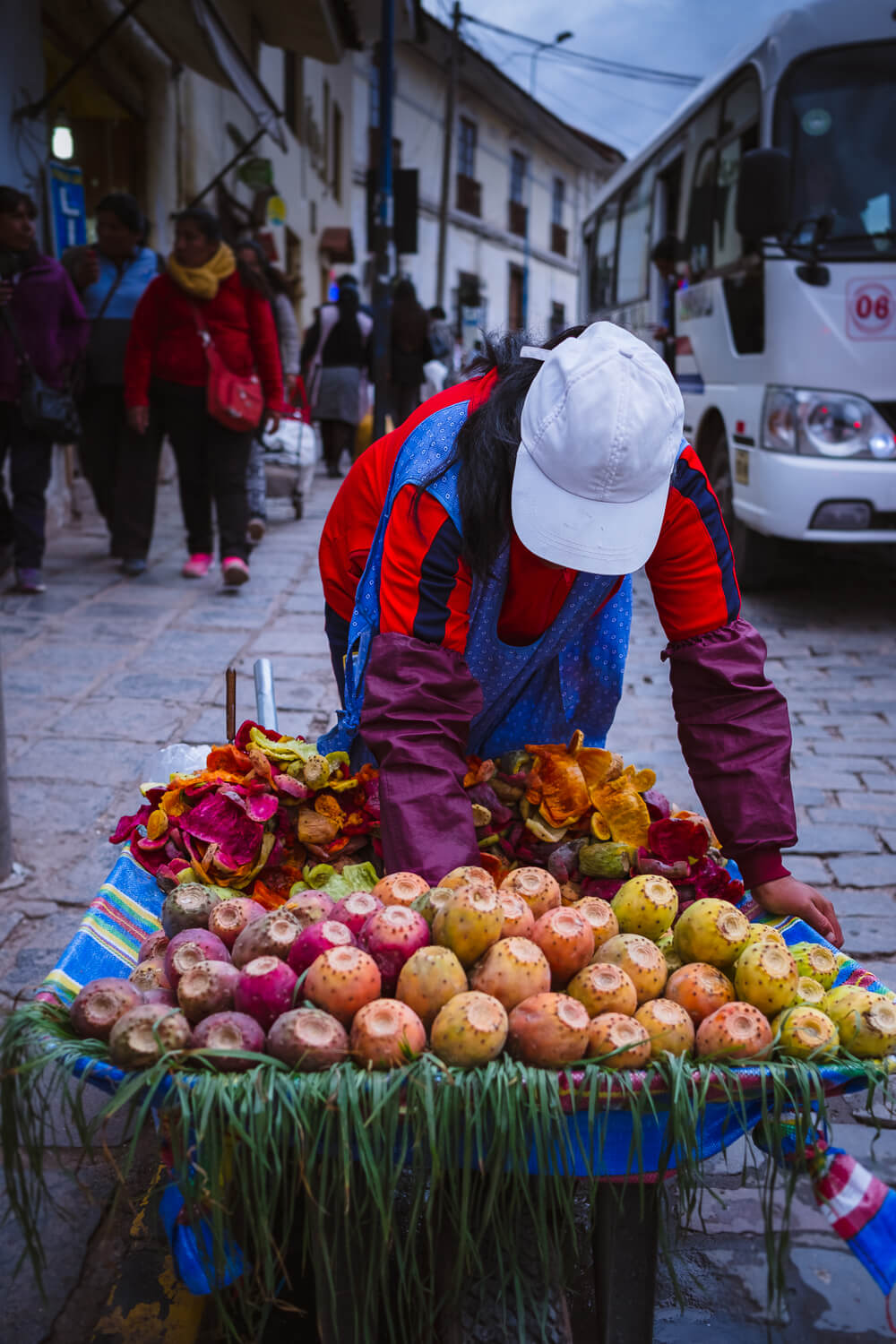 """Woman selling fruit, Cusco. Travel photography and guide by © Natasha Lequepeys for """"And Then I Met Yoko"""". #cusco #peru #photoblog #travelblog #peruitinerary #cuscoitinerary"""