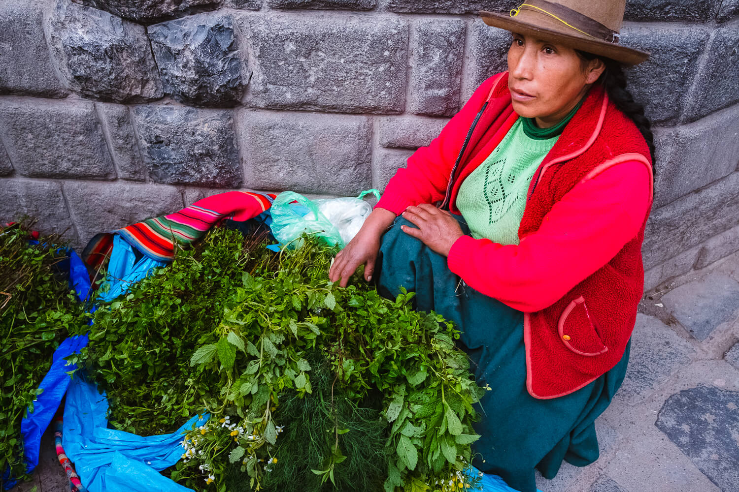 """Woman selling local herbs, Cusco. Travel photography and guide by © Natasha Lequepeys for """"And Then I Met Yoko"""". #cusco #peru #photoblog #travelblog #peruitinerary #cuscoitinerary"""