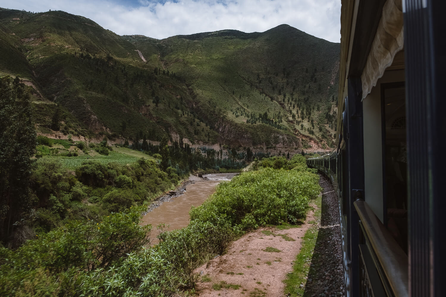 """Views of the Sacred Valley on the Belmond Andean Explorer. Travel photography and guide by © Natasha Lequepeys for """"And Then I Met Yoko"""". #peru #sacredvalley #patacancha #photoblog #travelblog #travelphotography #portraitphotography #travelitinerary #fujifilm #weaving #tradition #culture #people #andes #village #weavingdemonstration #cusco #ollantaytambo #travel #travelperu"""