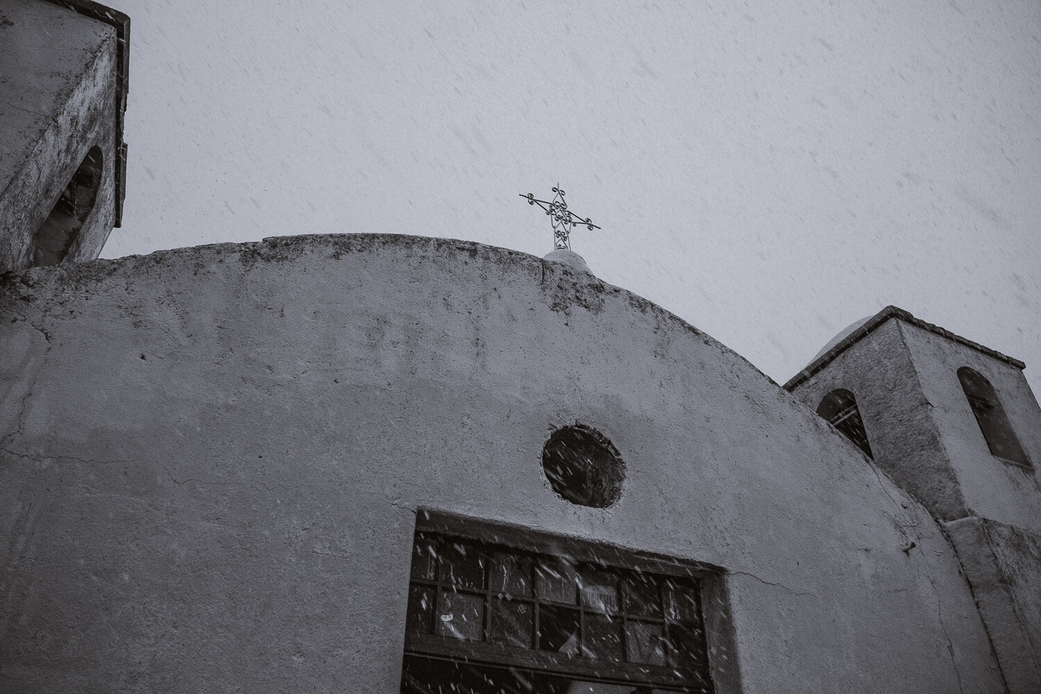 """Blizzard at a church in the Andes. Travel photography and guide by © Natasha Lequepeys for """"And Then I Met Yoko"""". #peru #sacredvalley #cusco #laketiticaca #belmondandeanexplorer #perurail #perutrain #luxurytravel #sleepertrain #photoblog #travelblog #travelphotography #fujifilm #andes #travel #travelperu #cuscotolaketiticaca #spiritofthelake #belmond #puno #southamerica"""